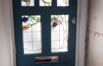Blue painted timber front door with stained glass panes
