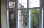 Timber windows with monkey tail handles