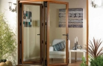 Wood effect uPVC bi-folding glass doors opening