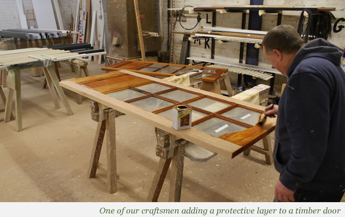 Wooden window receiving protective layer