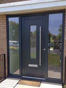 Black timber door installation