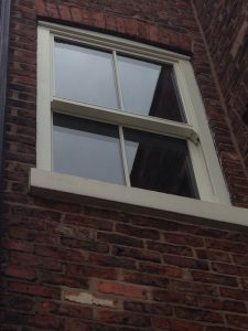 Single white timber sliding sash window