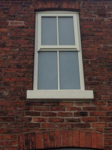 Cream timber sliding sash windows