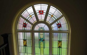 Arch Accoya window with leaded lights