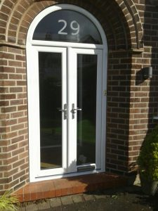 Arched white uPVC entrance door