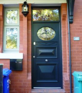 Black timber front door with decorative glass