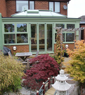 A timber orangery in traditional chartwell green