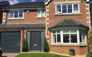 Black composite door and white uPVC windows