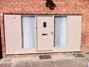 Pink Accoya wood panel timber doors with sidelights