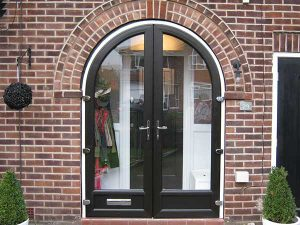 Black and white arched entrance door