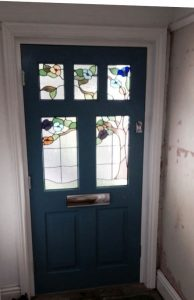 Stained glass timber blue door