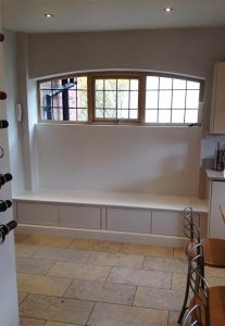 Arched timber windows with bars