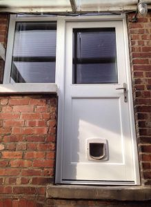 White timber back door with window
