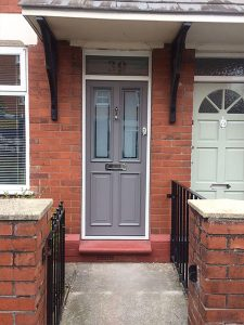 Grey timber entrance door with etched glass