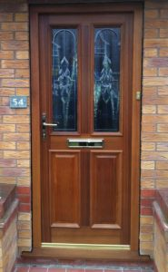 Timber entrance door with bevelled glass