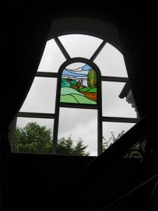 Timber window with stained glass