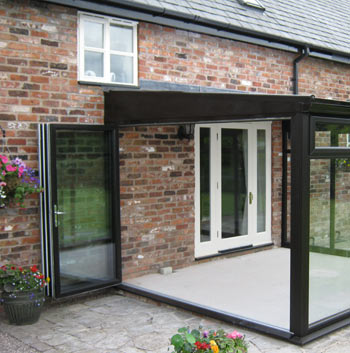 Black uPVC bifolds installed into a conservatory
