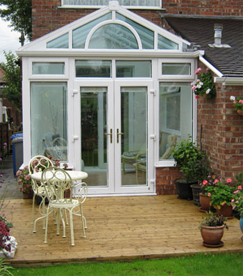 A uPVC conservatory next to decking