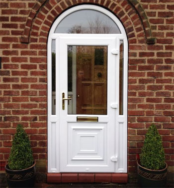 A uPVC front door with arched window above