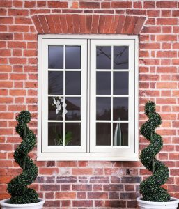 White Astragal window with bars