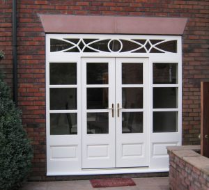 Hardwood patio doors with decorative glazing at the top