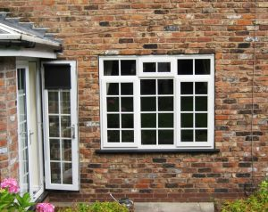 White squared timber leaded windows