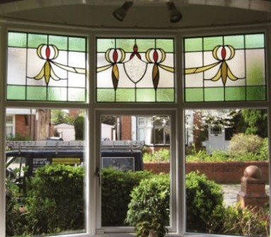 Stained glass windows with white Accoya wood frames by Reddish Joinery