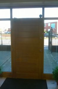 Accoya wood light oak coloured entrance door displayed in Reddish Joinery's Sale showroom