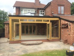 Bespoke timber orangery with oak effect bifolds
