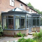 Grey timber orangery exterior