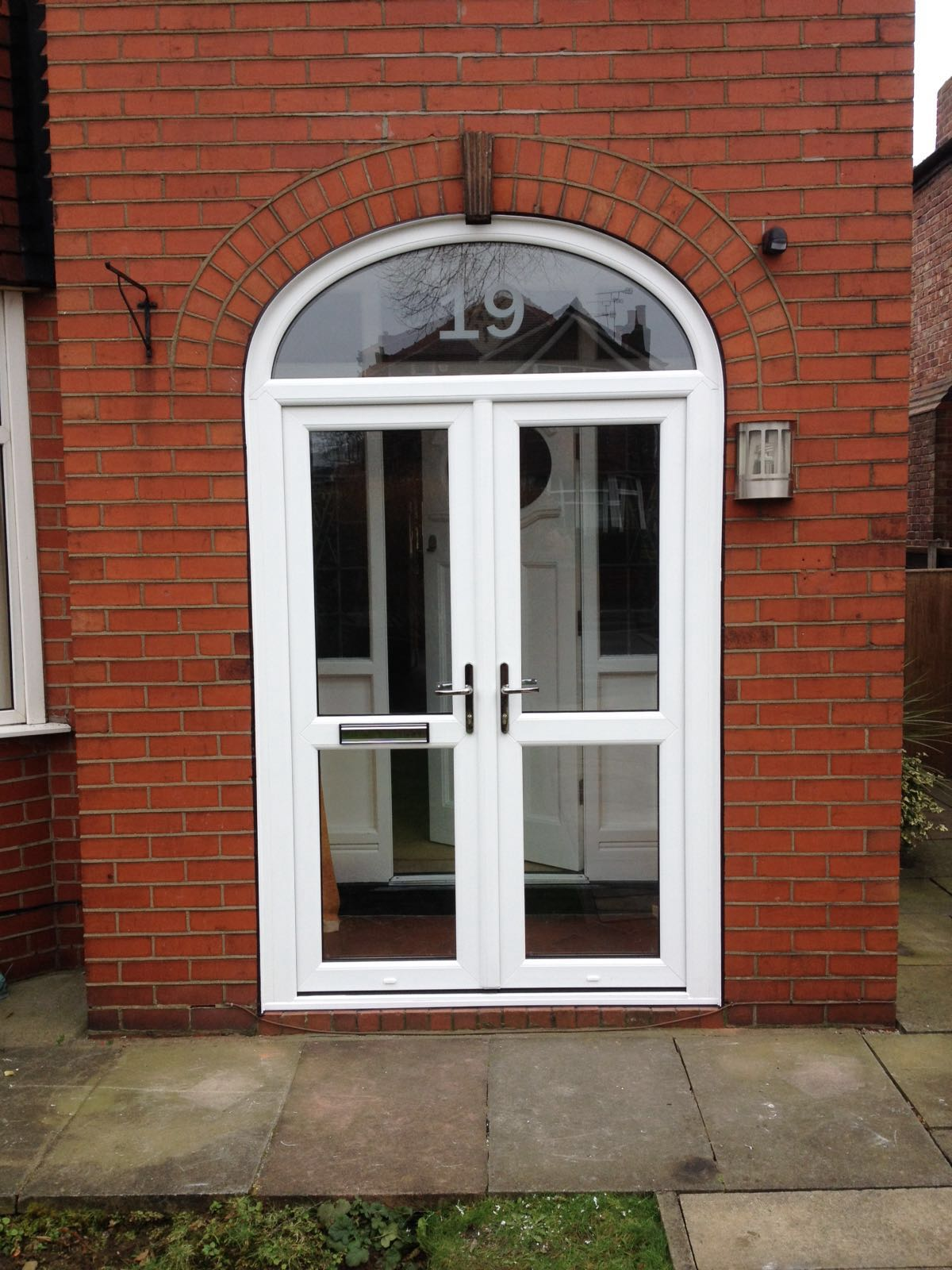 PVC arched porch with French doors