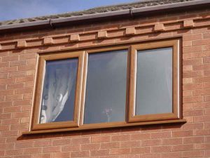 Timber effect oak look uPVC windows
