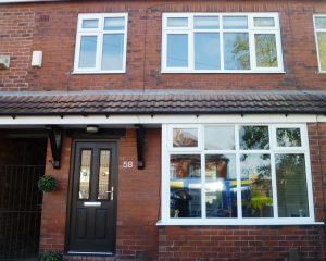 White uPVC windows and black composite door