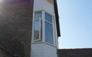 White uPVC bay cladding window