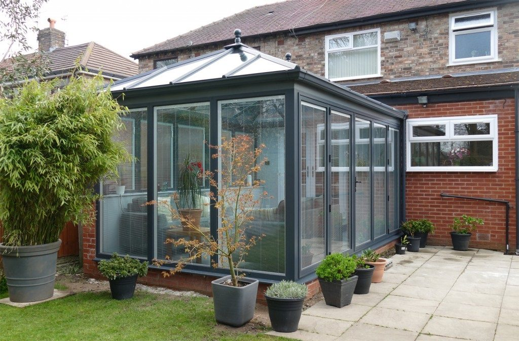 Grey glazed conservatory with integrated blinds