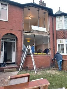 Bay windows being fitted