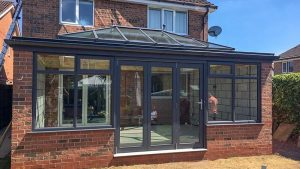 Black uPVC orangery with bifold doors