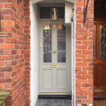 Accoya wood entrance door in lamp room Grey