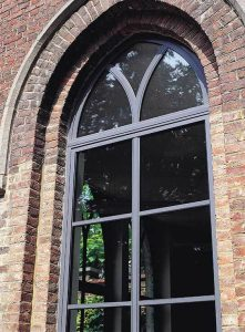 Modern arched aluminium window installation