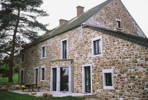 Traditional stone house with aluminium windows