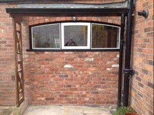 timber arched window exterior