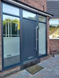 Modern grey composite door with glazing
