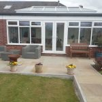 White bungalow orangery with French doors