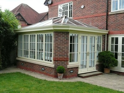 Painted timber orangery with glass lantern roof
