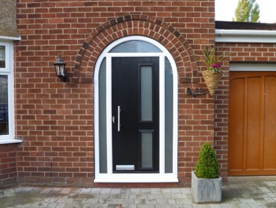 Black front door with white arch