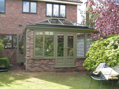Green timber orangery with lantern roof