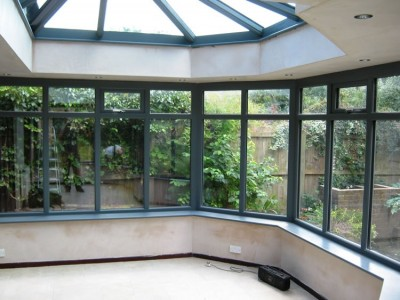 Inside a timber orangery with roof lantern