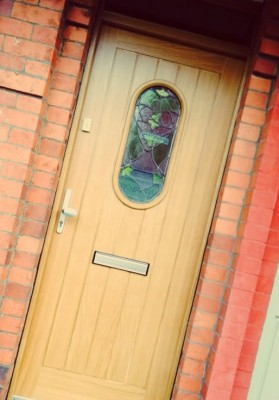 Oak front door with stained glass panel