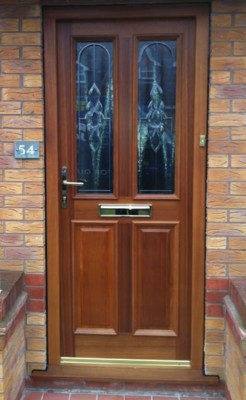 Timber front door with bevelled glass
